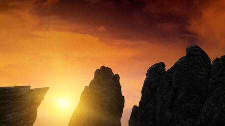 Mountain peak on sunset sky Stock Photo