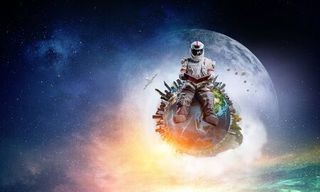 Spaceman and the planet Earth abstract theme 스톡 콘텐츠