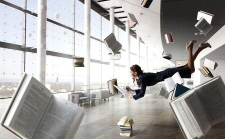 Joyful beautiful young levitating businesswoman Stock fotó