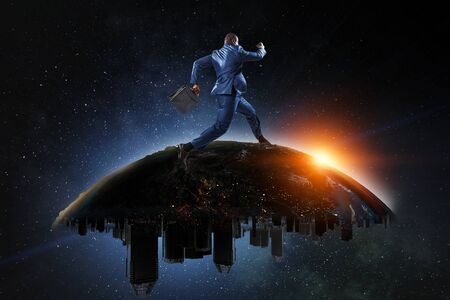 Back view of a black businessman running on the Globe with city scyscrapers on the starry space background