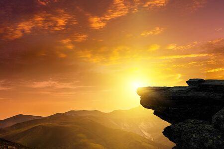 Mountain peak on sunset sky Фото со стока