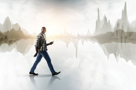 Black man in casual clothes in motion Stock Photo