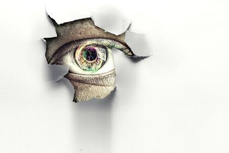 Eye peeping through hole. Mixed media Banco de Imagens - 129257722
