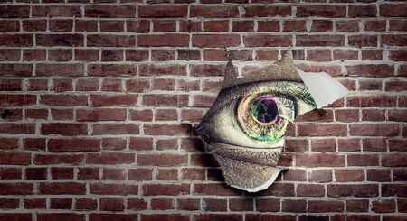 Eye peeping through hole. Mixed media 写真素材 - 129257746