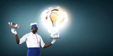 Cook preparing something special. Mixed media Stockfoto