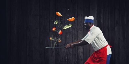 Black chef creative cooking. Mixed media. Stockfoto