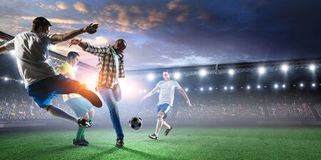 Soccer man in action with ball. Mixed media Stockfoto