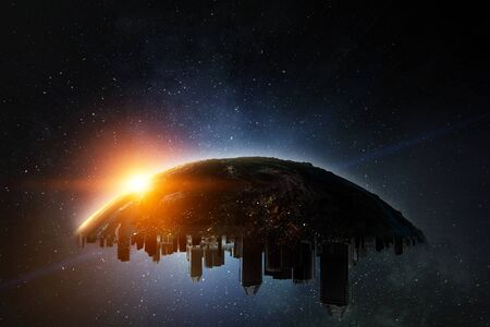 Upper side of Urban Globe with city scyscrapers turned upside down on the starry space background