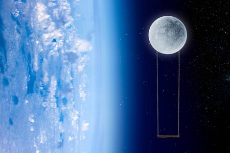 Earth and Moon with swings in blue space Stock fotó