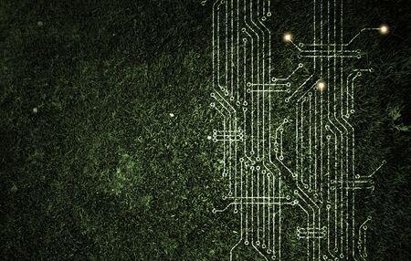 Microcircuit on green grass texture Stockfoto