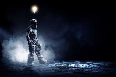 Astronaut in a space-suit on dark background