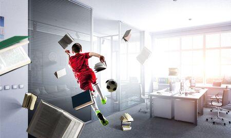 Man playing soccer in the office 版權商用圖片