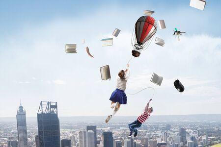Child fly on aerostat. Mixed media 版權商用圖片