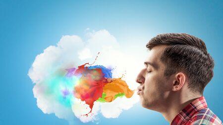 Guy presenting creativity concept . Mixed media Stok Fotoğraf