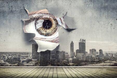 Eye peeping through hole. Mixed media Stockfoto - 133886099