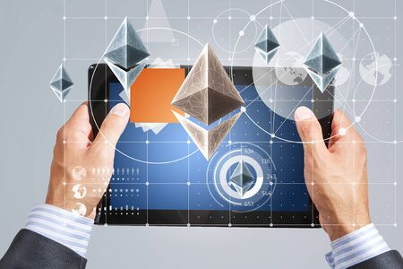 Close of businessman using tablet pc and bitcoin icons as concept. 3D rendering Фото со стока