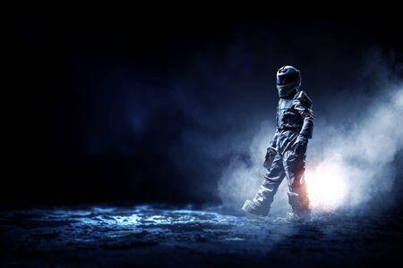 Astronaut man wearing suit in space. Mixed media Foto de archivo