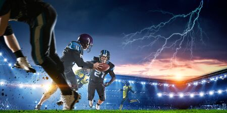 American football players in professional sport stadium. Mixed media Stock Photo