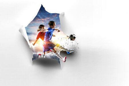 Boy with soccer ball out of torn paper. Mixed media Stock Photo
