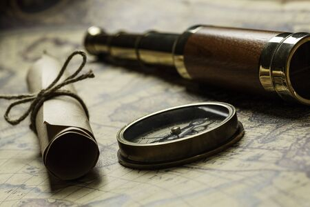 Concept of travel and discovery with old map and compass on it Stock fotó