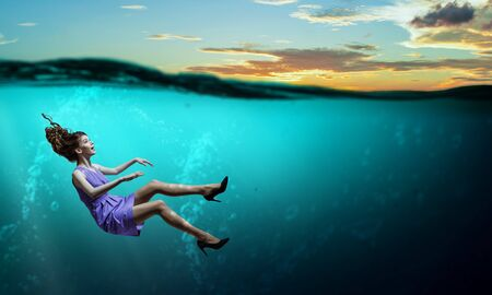 Sinking in problems . Mixed media Stock Photo