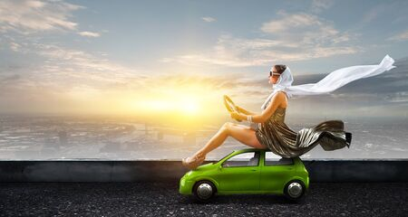 Woman sit on top of car and driving concept.