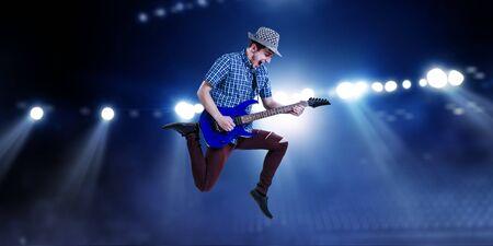 Guitarist at concert. Mixed media