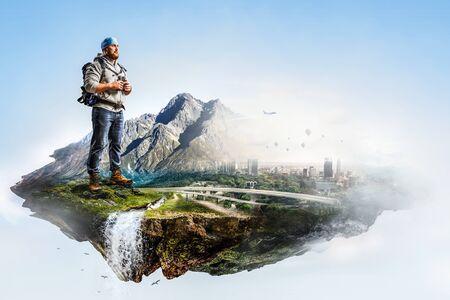 Hiker man with sticks. Mixed media Reklamní fotografie
