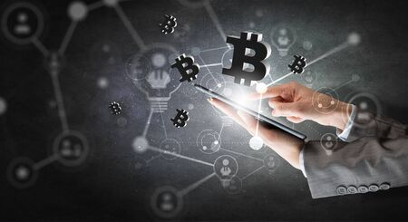 Close of businesswoman using tablet pc and bitcoin icons as concept. 3D rendering