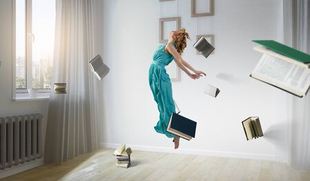 Woman floating with around books in room concept. Mixed media
