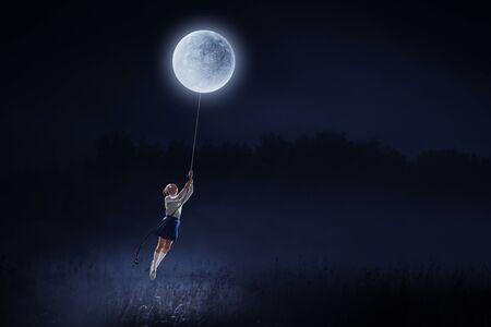 Girl of school age flying moon balloon. Mixed media