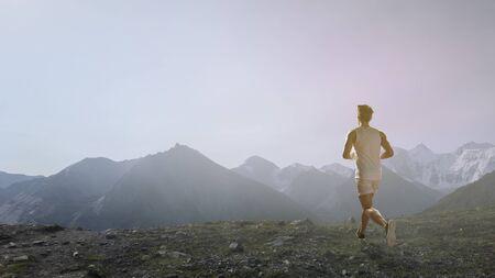 Sportsman running race. Mixed media
