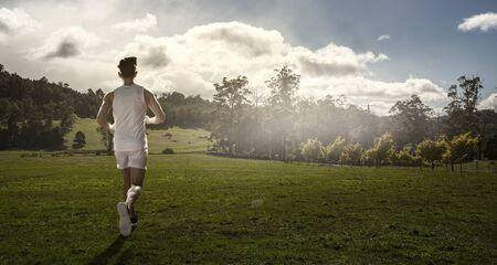 Sportsman running race. Mixed media Imagens