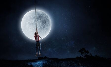 Boy of school age flying moon balloon. Mixed media