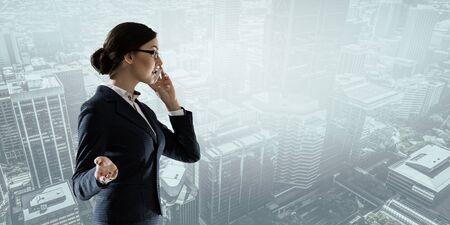 Businesswoman having dialogue . Mixed media Standard-Bild