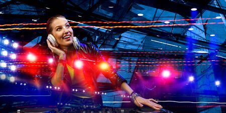 Female dj at console. Mixed media