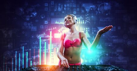 Cute dj woman at console. Mixed media Reklamní fotografie