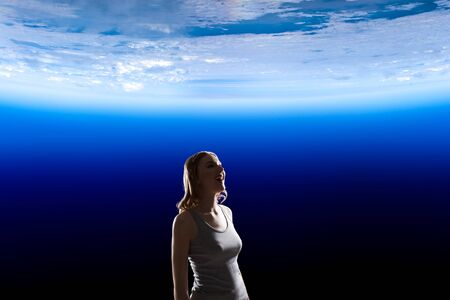 Girl looking at Earth planet
