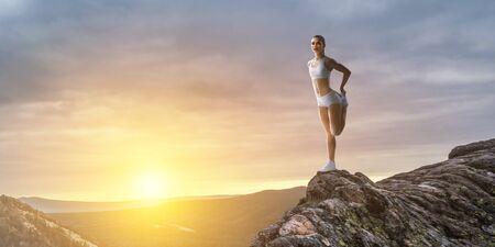 Athlete woman outdoors. Mixed media
