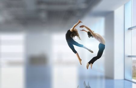 Couple of gymnasts dancing together. Mixed media Stock Photo