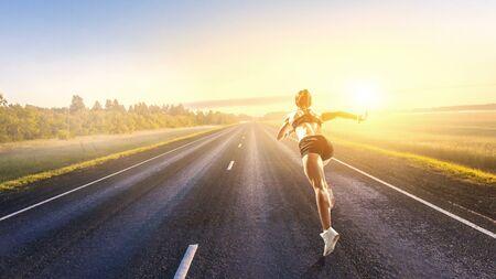 Beautiful woman running cross country. Mixed media