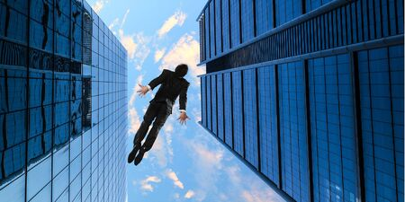 Bottom view of skyscraper and businessman falling from sky. Mixed media Stock Photo