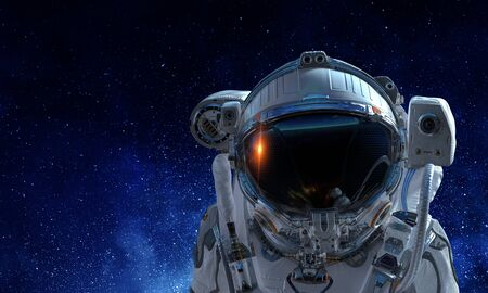 Astronaut man on space mission with starry sky on the background. Mixed media Stock Photo