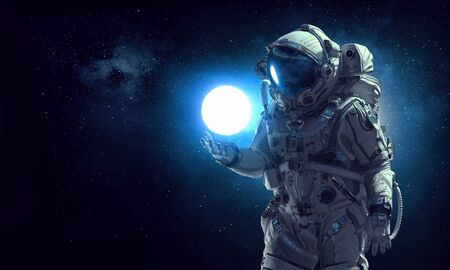 Astronaut holding moon planet in palm.