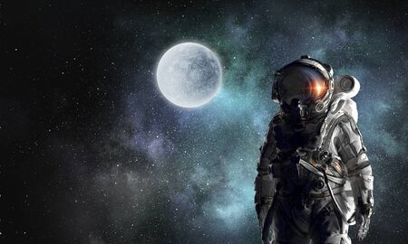 Space explorer in astronaut suit. Mixed media Stock Photo