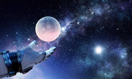 Astronaut hand and moon planet. Stock Photo