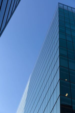 Low angle shot of modern glass city buildings