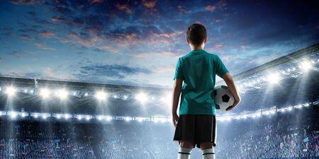 Kid on a soccer stadium. Mixed media