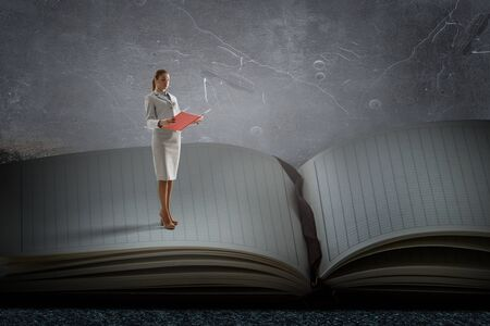 Giant book and reading person