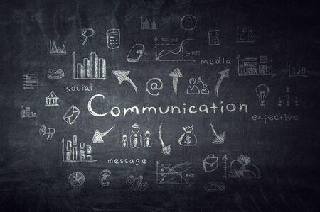 Black chalkboard with word communication and symbols. Mixed media Standard-Bild